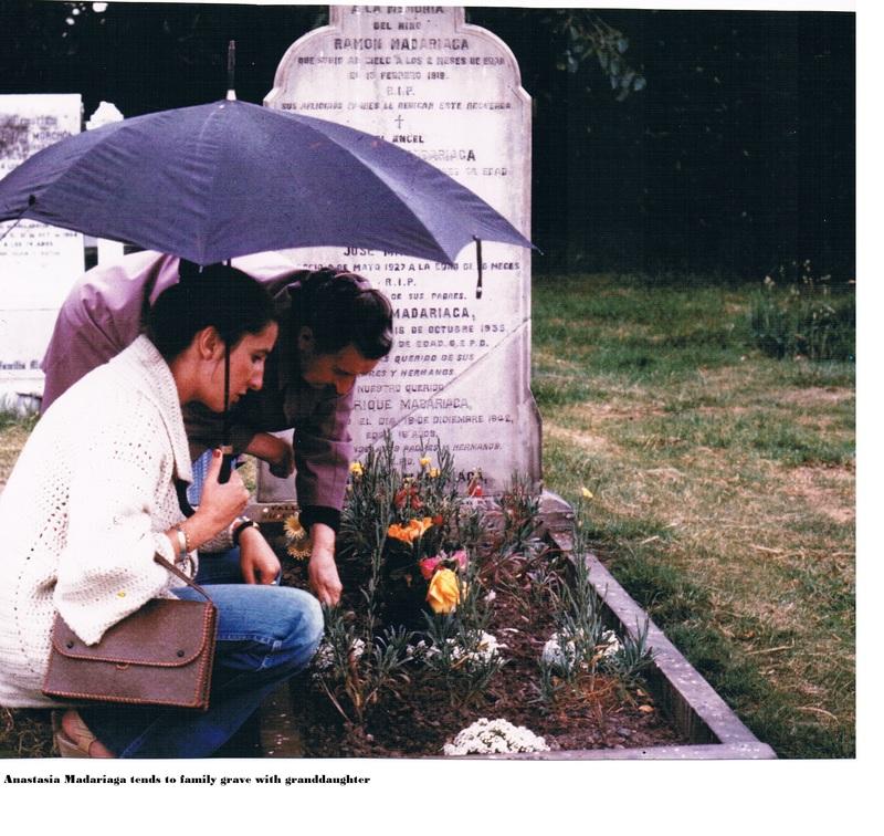 Anastasia Madariaga tends to a family grave with granddaughter.jpg