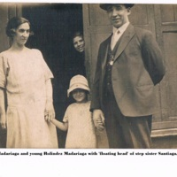 Francisco Anastasia and young Rolindez Madariaga with 'floating head' of step-sister Santiaga. Liverpool..jpg